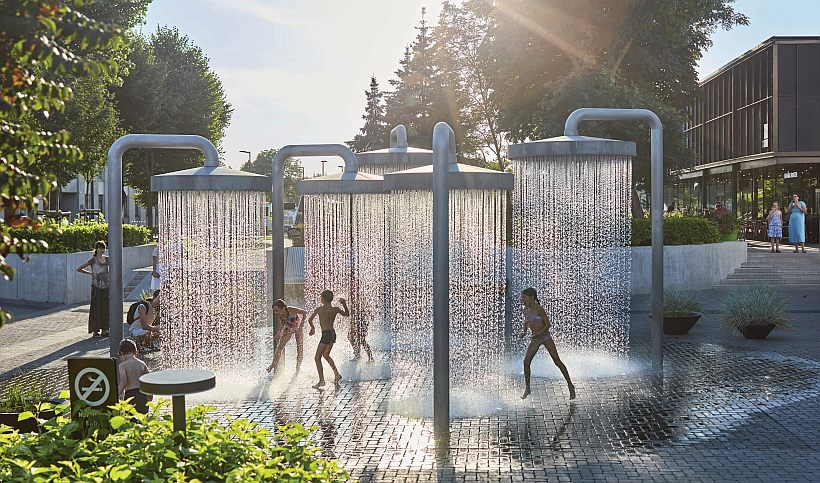 02_A_Ogmios City_Do Architects_ Children playing in lower square with fountain